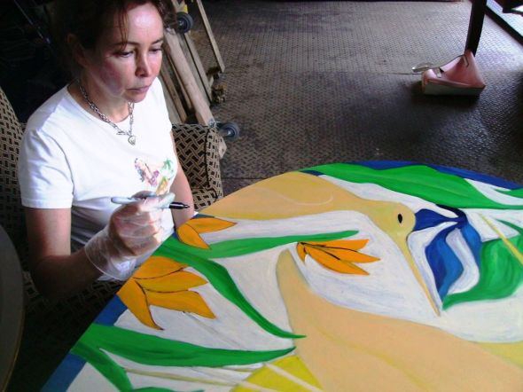 Paulette Lust creates an original piece of art for Operation Green Leaves